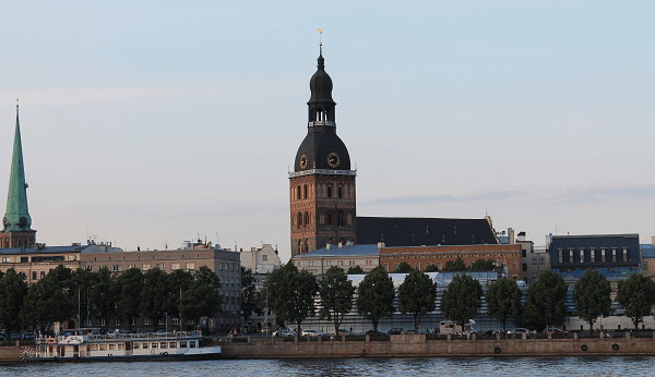 Dome Cathedral In Riga A View From River Daugava Boat Tour.